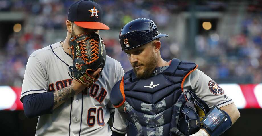 Houston Astros starting pitcher Dallas Keuchel (60) chats with catcher Max Stassi (12)  in the first inning of an MLB baseball game Globe Life Park, Friday, March 30, 2018, in Arlington.   ( Karen Warren / Houston Chronicle ) Photo: Karen Warren/Houston Chronicle
