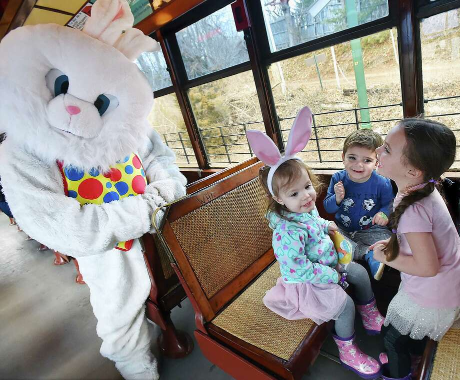 Penelope Monk, 4 and her 2-year-old sister Giulitta and their cousin Harper, 1, play with the Easter Bunny on trolley at the Shore Line Trolley Museum, Friday, March 30, 2018, at 17 River Street in East Haven. The museum is operated by the Branford Electric Railway Association. Photo: Catherine Avalone, Hearst Connecticut Media / New Haven Register