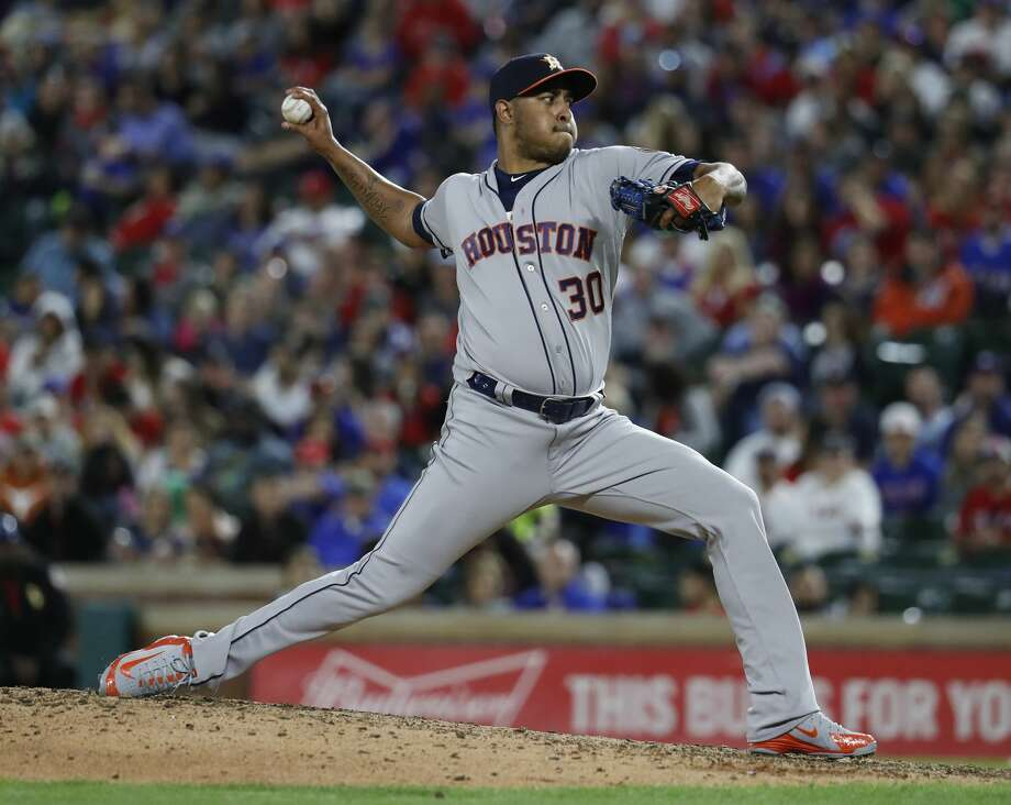 Houston Astros relief pitcher Hector Rondon (30) pitches in the eighth inning of an MLB baseball game Globe Life Park, Friday, March 30, 2018, in Arlington.   ( Karen Warren / Houston Chronicle ) Photo: Karen Warren/Houston Chronicle