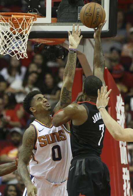 Houston Rockets guard Joe Johnson (7) tries to put the ball into the basket while Phoenix Suns forward Marquese Chriss (0) is trying to block him during the second quarter of the NBA game at Toyota Center on Friday, March 30, 2018, in Houston. ( Yi-Chin Lee / Houston Chronicle ) Photo: Yi-Chin Lee/Houston Chronicle