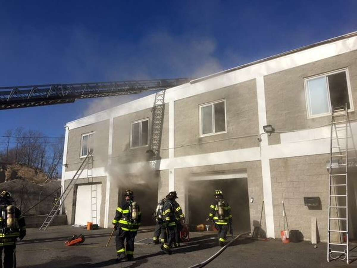 One person was sent to the hospital after a fire broke out at a South Norwalk business on Saturday, March 31, 2018.