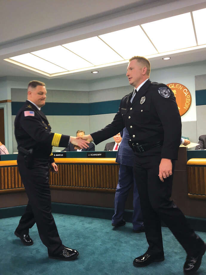 Glen Carbon Police Chief Todd Link, left, congratulates Officer Justin Click who was promoted to the rank of sergeant in the Glen Carbon Police Department. Click has been with the department since 2011 Photo: John Sommerhof • Jsommerhof@edwpub.net