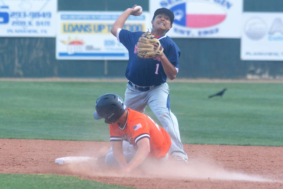 Plainview infielder Eli Munoz tries to turn a double play as a sliding Dumas base runner bears down on him during a District 3-5A baseball game Tuesday. The Bulldogs beat Dumas twice during the week and improved to 6-0 in district play. Photo: Skip Leon/Plainview Herald