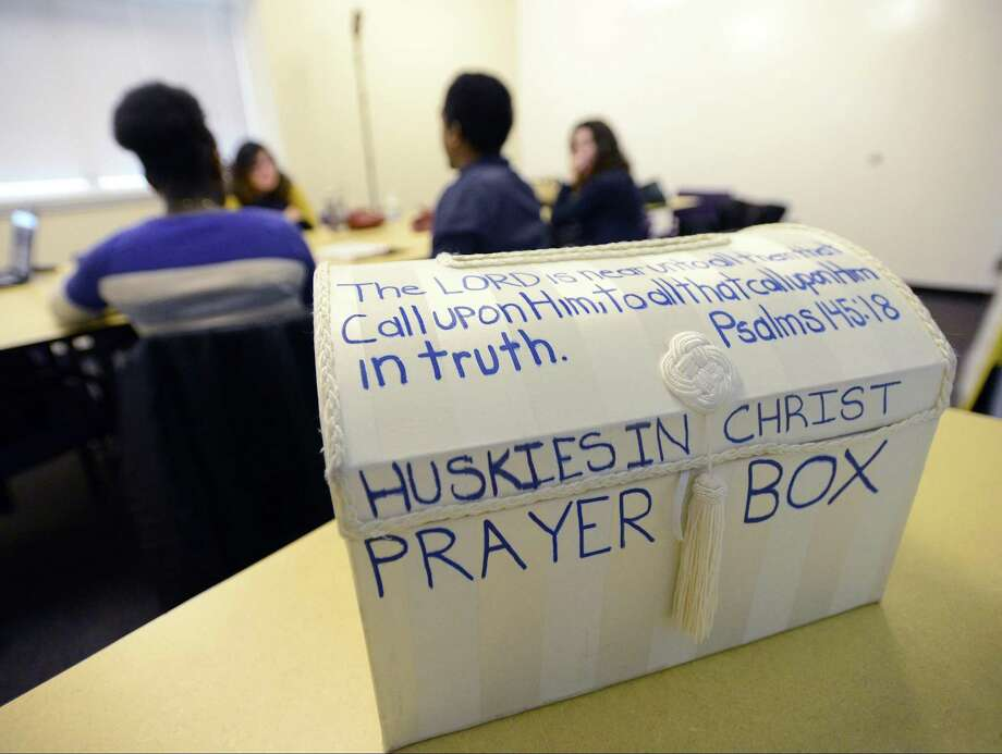 "Members of the ""Huskies in Christ"" gather for a bi-weekly meeting to talk about religion at UConn Stamford on Thursday, March 29, 2018. The club, one of several student clubs on campus, often hold open discussions on various religious views. Photo: Matthew Brown / Hearst Connecticut Media / Stamford Advocate"