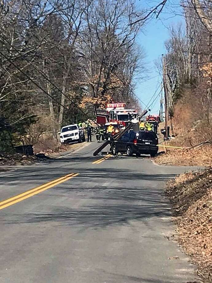 Firefighters responded to a one-car crash on Walnut Street in Monroe, Conn., where they found a vehicle had knocked down an Eversource pole and live wires were down. Eversource was called to respond on a priority. Photo: Contributed Photo / Monroe Volunteer Fire Department / Contributed Photo / Connecticut Post Contributed