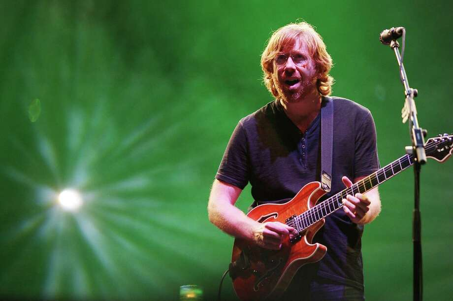 "FILE - In this June 12, 2009 file photo provided by Fuse TV via Starpix, Trey Anastasio of the ""Jam Band"" Phish performs at Bonaroo 2009, in Manchester Tenn. (AP Photo/Starpix, Amanda Schwab, file) Photo: Amanda Schwab"