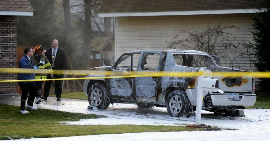 A police investigation is underway after a truck exploded in a Colonie driveway this morning. The explosion at 24 Garling Drive rocked the quiet neighborhood shortly after 7 a.m.  (Skip Dickstein / Times Union) Photo: SKIP DICKSTEIN