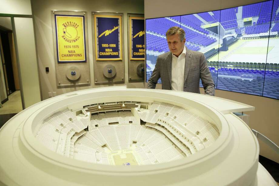 In this photo taken Jan. 24, 2018, Golden State Warriors President and COO Rick Welts looks over a model of Chase Center at the Chase Center Experience in San Francisco. Welts, who turned 65 in January and is the first openly gay NBA executive, can lean not only on the time with the Seattle SuperSonics but also his experience in the league office and with Phoenix to see what things work and don't work when it comes to operating a franchise, to building an arena. (AP Photo/Eric Risberg) Photo: Eric Risberg / AP / Copyright 2018 The Associated Press. All rights reserved.