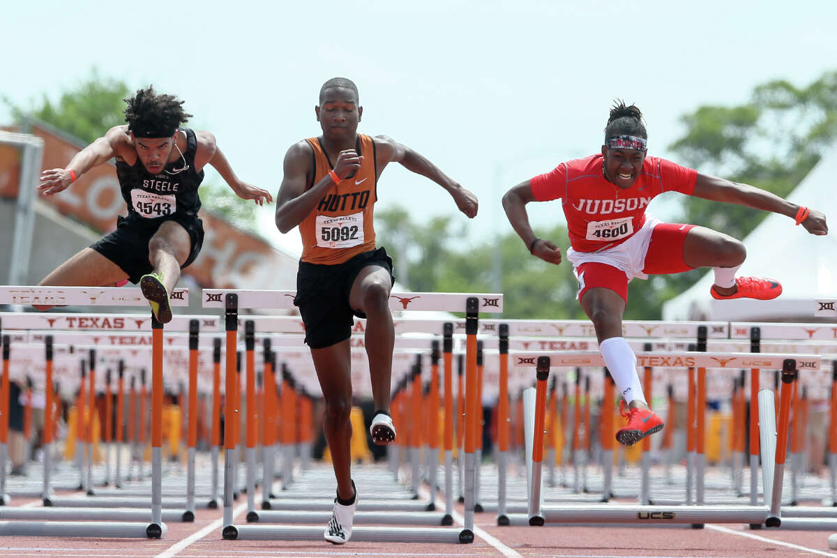 Hutto's De'vion Wilson (center) clears the final hurdle in the high school boys division II 110-meter hurdles ahead of Steele's Kenney Broadnax (left) and Tre'Bien Gilbert during the Clyde Littlefield Texas Relays at Mike A. Myers Stadium in Austin on Saturday, March 31, 2018. Wilson won the event with a time of 13.72 seconds. Gilbert finisheed second with 13.91 and Broadnax fourth with 14.00. MARVIN PFEIFFER/mpfeiffer@express-news.net