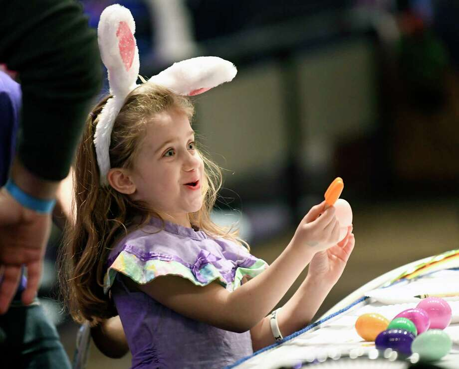 Lillian Evans age 5 years of Rotterdam, N.Y., opens an easter egg during the governor's Easter open house at the Empire Convention Center Saturday, March 31, 2018, in Albany, N.Y. (Photo/Hans Pennink) (Hans Pennink / Special to the Times Union) Photo: Hans Pennink / Hans Pennink