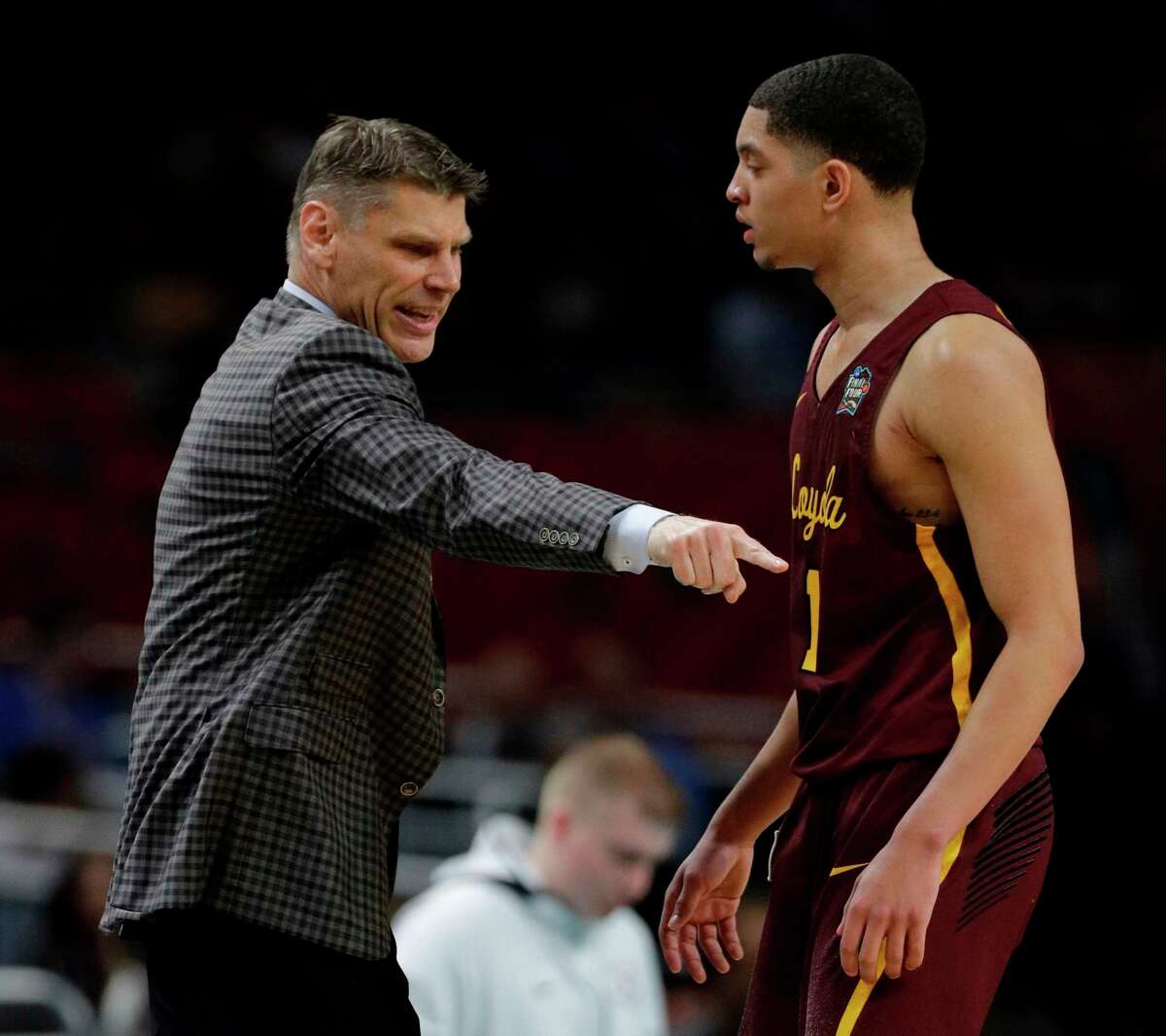 Loyola-Chicago head coach Porter Moser, left, talks with guard Lucas Williamson during the first half against Michigan in the semifinals of the Final Four NCAA college basketball tournament, Saturday, March 31, 2018, in San Antonio.