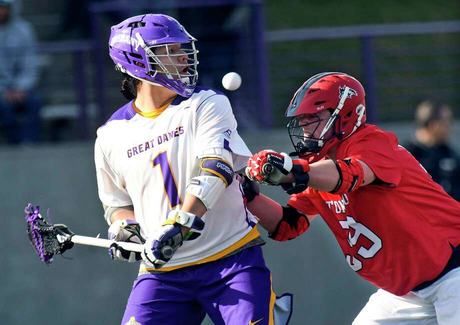 University at Albany's Tehoka Nanticoke (1) passes the ball behind his back against Stony Brook defender Danny Cassidy (99) during a NCAA Division I college men's lacrosse game on Saturday, March 31, 2018, in Albany, N.Y. (Hans Pennink / Special to the Times Union) Photo: Hans Pennink / Hans Pennink