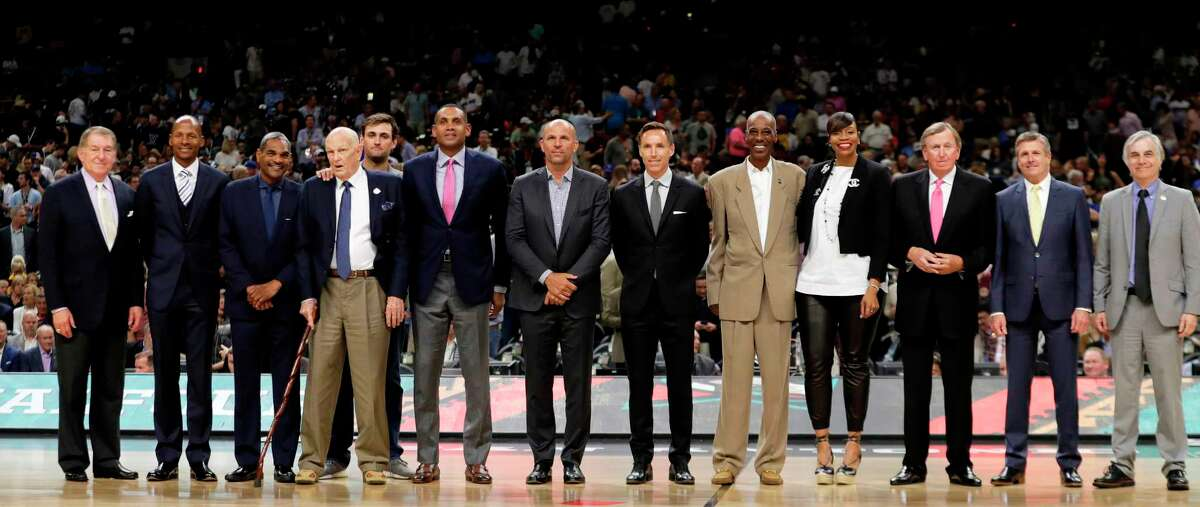 Members of the Naismith Memorial Basketball Hall of Fame Class of 2018 are introduced during halftime of a semifinal game between Loyola-Chicago and Michigan in the Final Four NCAA college basketball tournament, Saturday, March 31, 2018, in San Antonio.