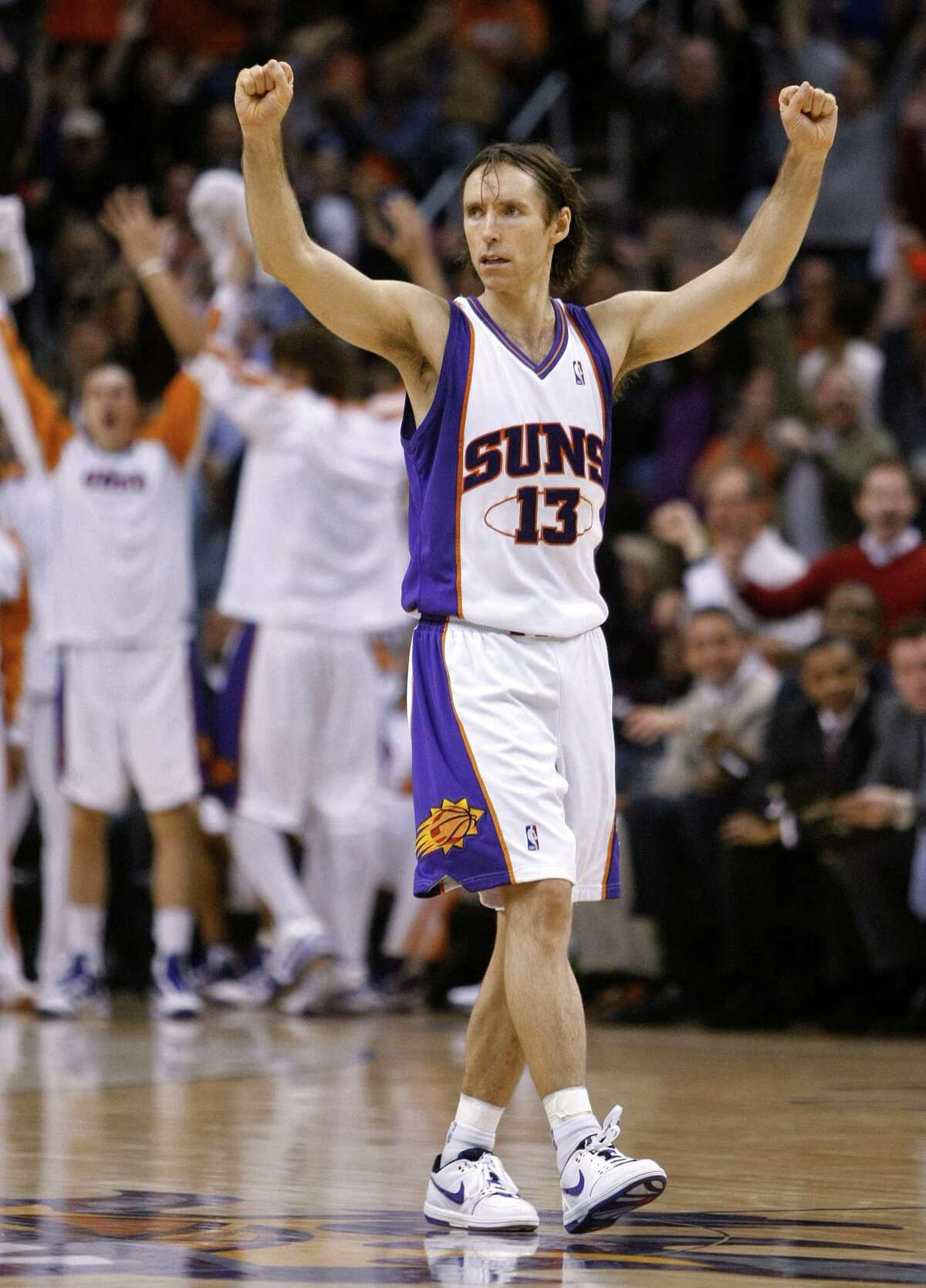 Phoenix Suns' Steve Nash cheers during the second half of the Suns' 118-103 win over the Los Angeles Lakers in an NBA basketball game Monday, Dec. 28, 2009, in Phoenix. (AP Photo/Matt York)