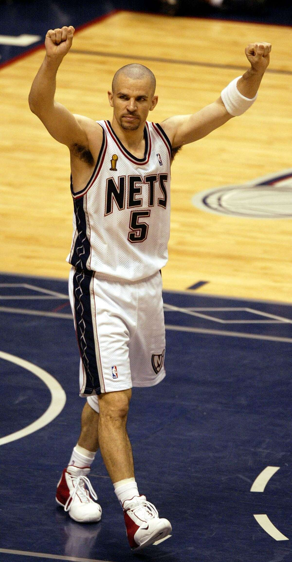 New Jersey Nets' Jason Kidd celebrates the Nets 77-76 win over the San Antonio Spurs' during Game 4 of the NBA Finals Wednesday, June 11, 2003 in East Rutherford, NJ. (AP Photo/Miles Kennedy)
