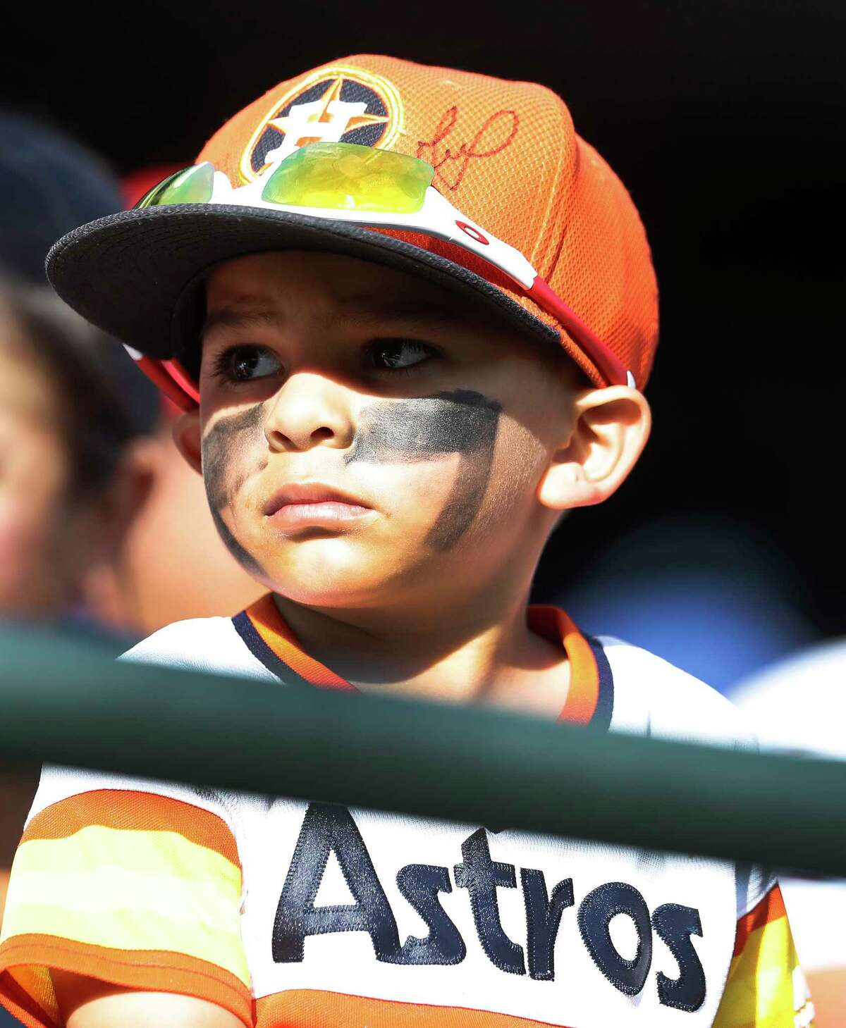 Davian Mendoza, 3, of Odessa, watches the game with his Astros gear and eye black on in the eighth inning of an MLB baseball game at Globe Life Park, Saturday, March 31, 2018, in Arlington.