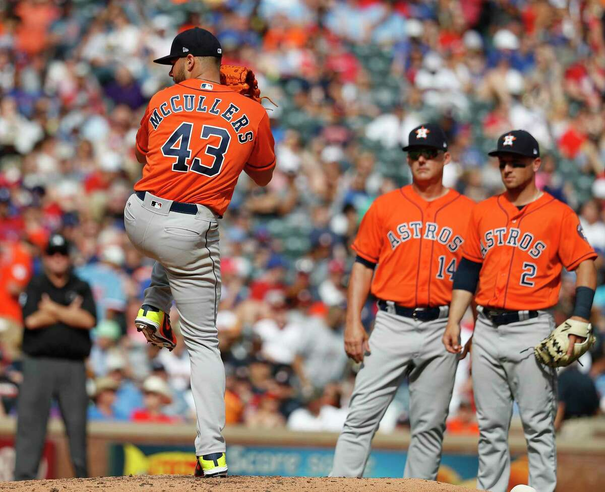 Houston Astros starting pitcher Lance McCullers Jr. (43) tests his leg after getting hit by a comebacker to the mound in the fourth inning of an MLB baseball game at Globe Life Park, Saturday, March 31, 2018, in Arlington.