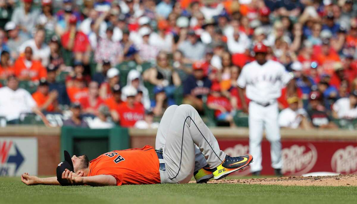 Houston Astros starting pitcher Lance McCullers Jr. (43) reacts after getting hit by a comebacker to the mound in the fourth inning of an MLB baseball game at Globe Life Park, Saturday, March 31, 2018, in Arlington.