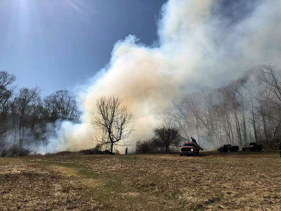 The fire was initially reported around 4:30 p.m. Shortly after 5 p.m., Derby fire officials said crews were on scene for a large brush fire in Osbornedale State Park, 555 Roosevelt Drive in Derby, Conn., on March 31, 2018. Photo: Contributed Photo / Derby Fire Department / Connecticut Post Contributed