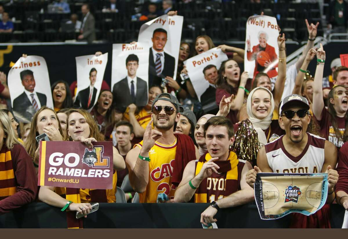 Fans from Loyola Chicago cheer while their team warm-ups on the floor on Saturday, March 31 ,2018 at the Alamodome