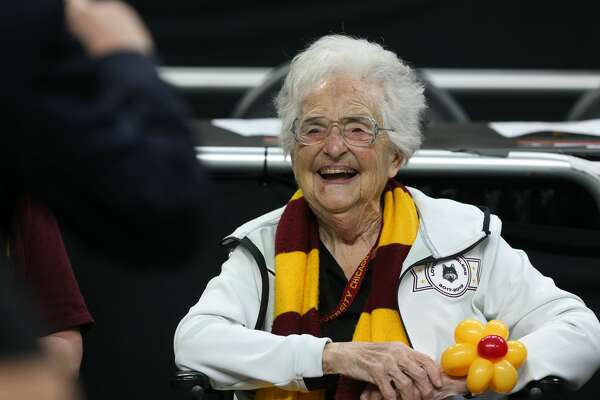 Sister Jean Delores Schmidt, 98, waits for the start of Saturday's game to cheer on the Loyola Chicago men's basketball team of the National Semi-Final of the NCAA Final Four at the Alamodome.  She's the chaplain of the Loyola Chicago men's basketball team.  Jerry Lara/Express-News
