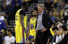 Golden State Warriors head coach Steve Kerr, right, talks to Draymond Green during the second half of an NBA basketball game against the Milwaukee Bucks Thursday, March 29, 2018, in Oakland, Calif. (AP Photo/Marcio Jose Sanchez)