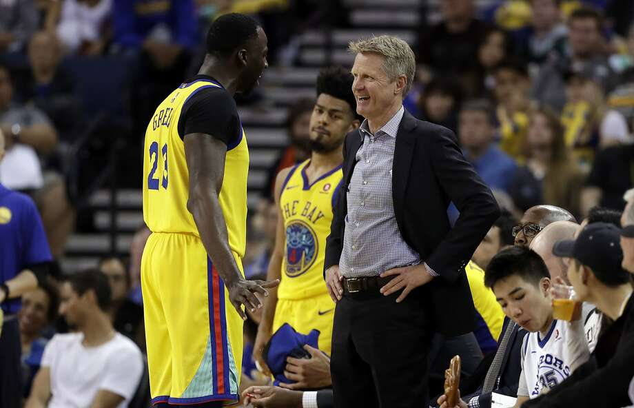 Golden State Warriors head coach Steve Kerr, right, talks to Draymond Green during the second half of an NBA basketball game against the Milwaukee Bucks Thursday, March 29, 2018, in Oakland, Calif. (AP Photo/Marcio Jose Sanchez) Photo: Marcio Jose Sanchez / Associated Press
