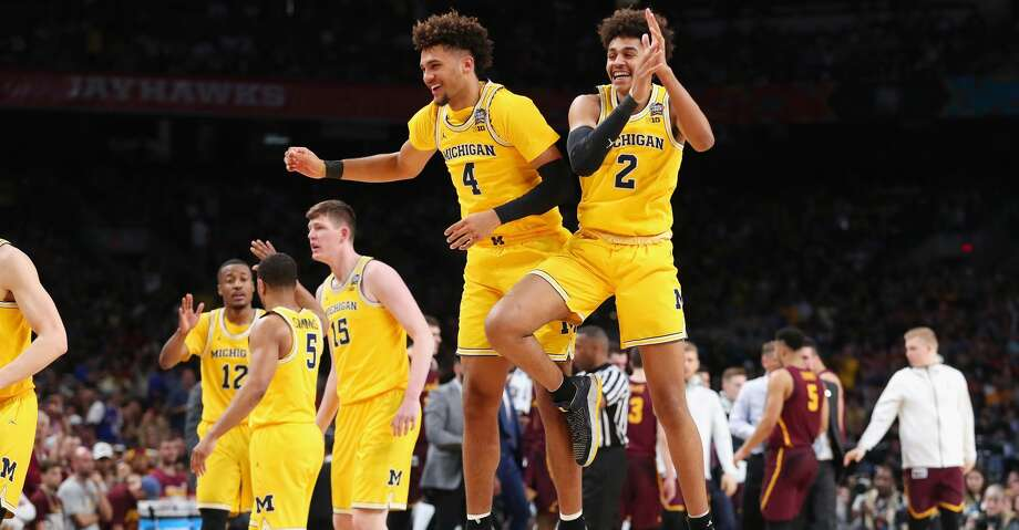 SAN ANTONIO, TX - MARCH 31:  Isaiah Livers #4 and Jordan Poole #2 of the Michigan Wolverines celebrate in the second half against the Loyola Ramblers during the 2018 NCAA Men's Final Four Semifinal at the Alamodome on March 31, 2018 in San Antonio, Texas.  (Photo by Tom Pennington/Getty Images) Photo: Tom Pennington/Getty Images