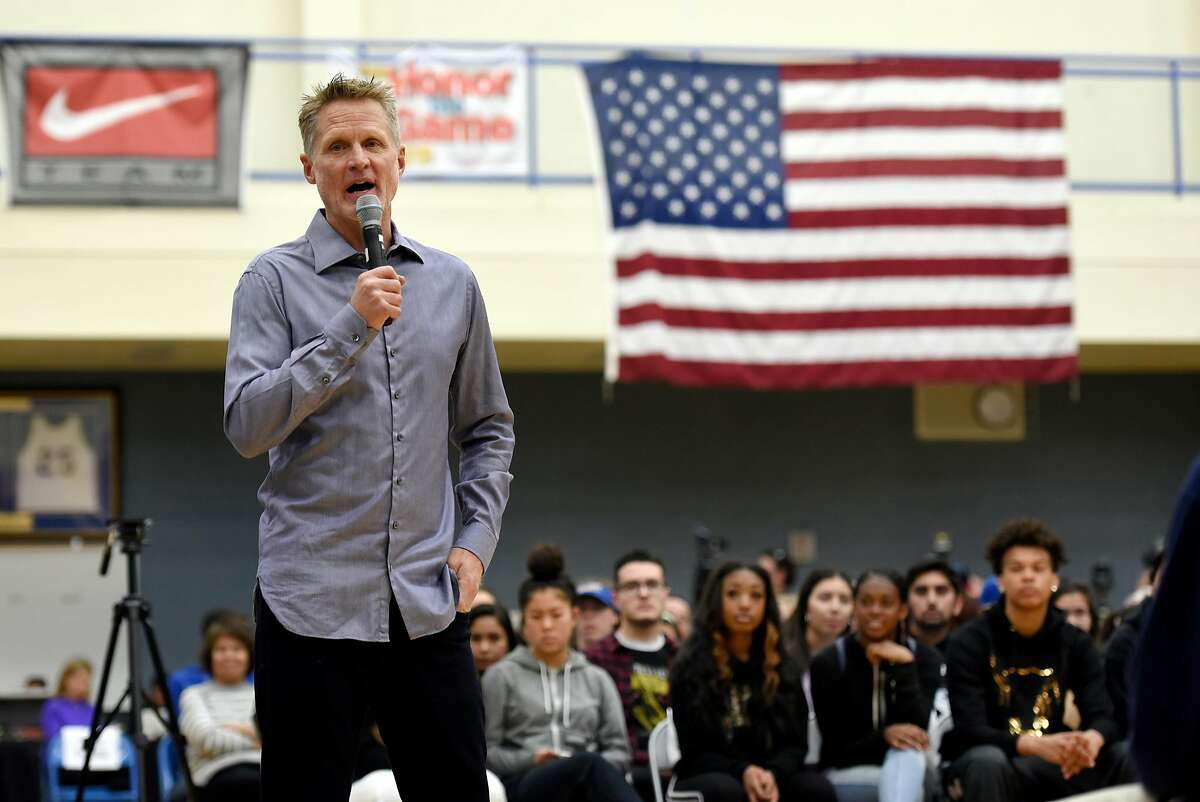 Golden State Warriors head coach Steve Kerr speaks with students at Newark Memorial High School during a panel discussion on gun violence, in Newark, Calif., on Monday March 12, 2018.