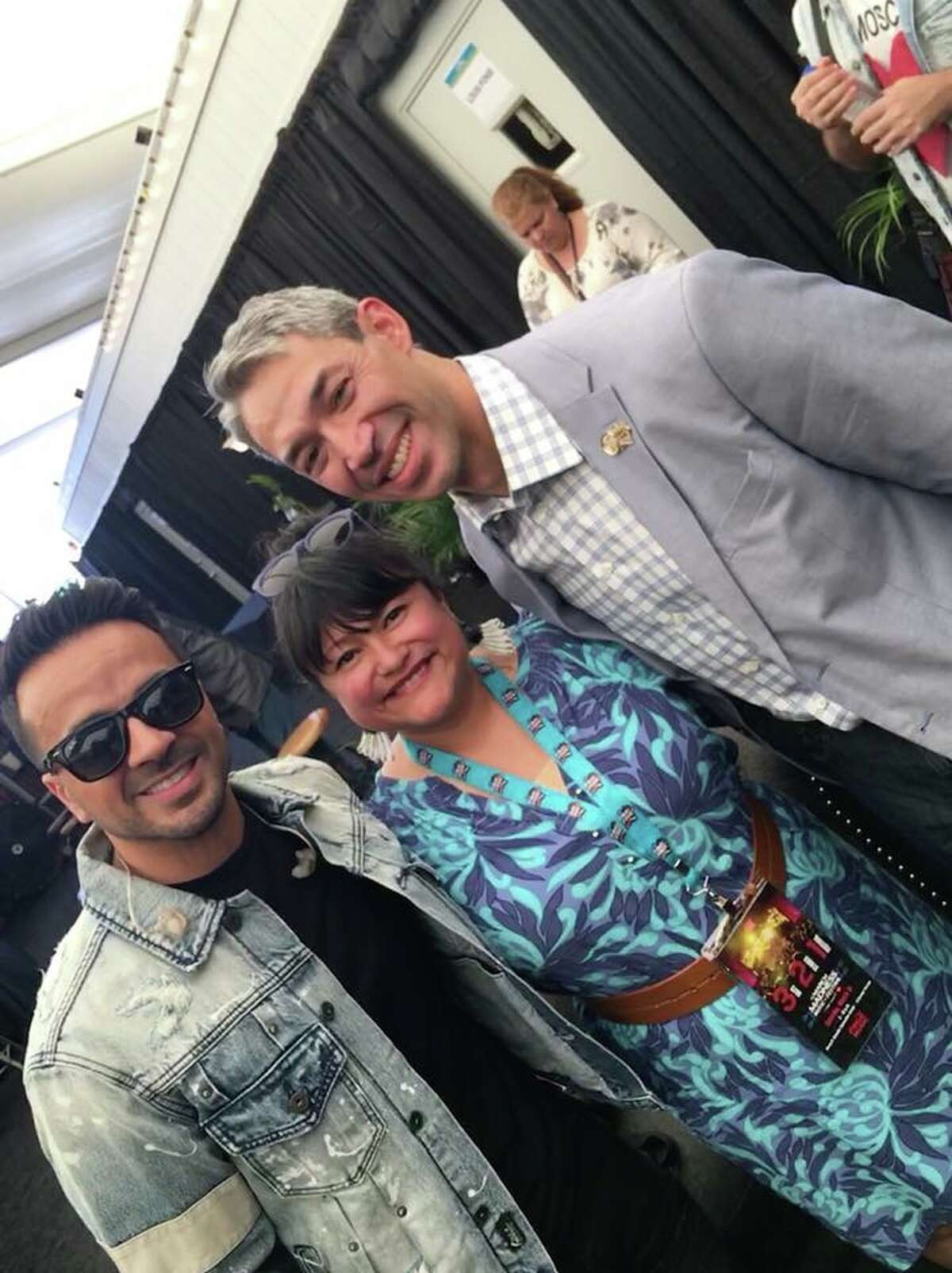 Luis Fonsi Singer Luis Fonsi invited San Antonio Mayor Ron Nirenberg, his wife Erika Prosper, and local fashion guru/entertainment mavin Michael Quintanilla backstage before his set at the March Madness Music Fest at Hemisfair Park Saturday afternoon, March 31, 2018.