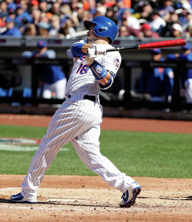 New York Mets' Travis d'Arnaud (18) follows through with a home run during the fourth inning of a baseball game against the St. Louis Cardinals, Saturday, March 31, 2018, in New York. (AP Photo/Frank Franklin II) Photo: Frank Franklin II / Copyright 2018 The Associated Press. All rights reserved.