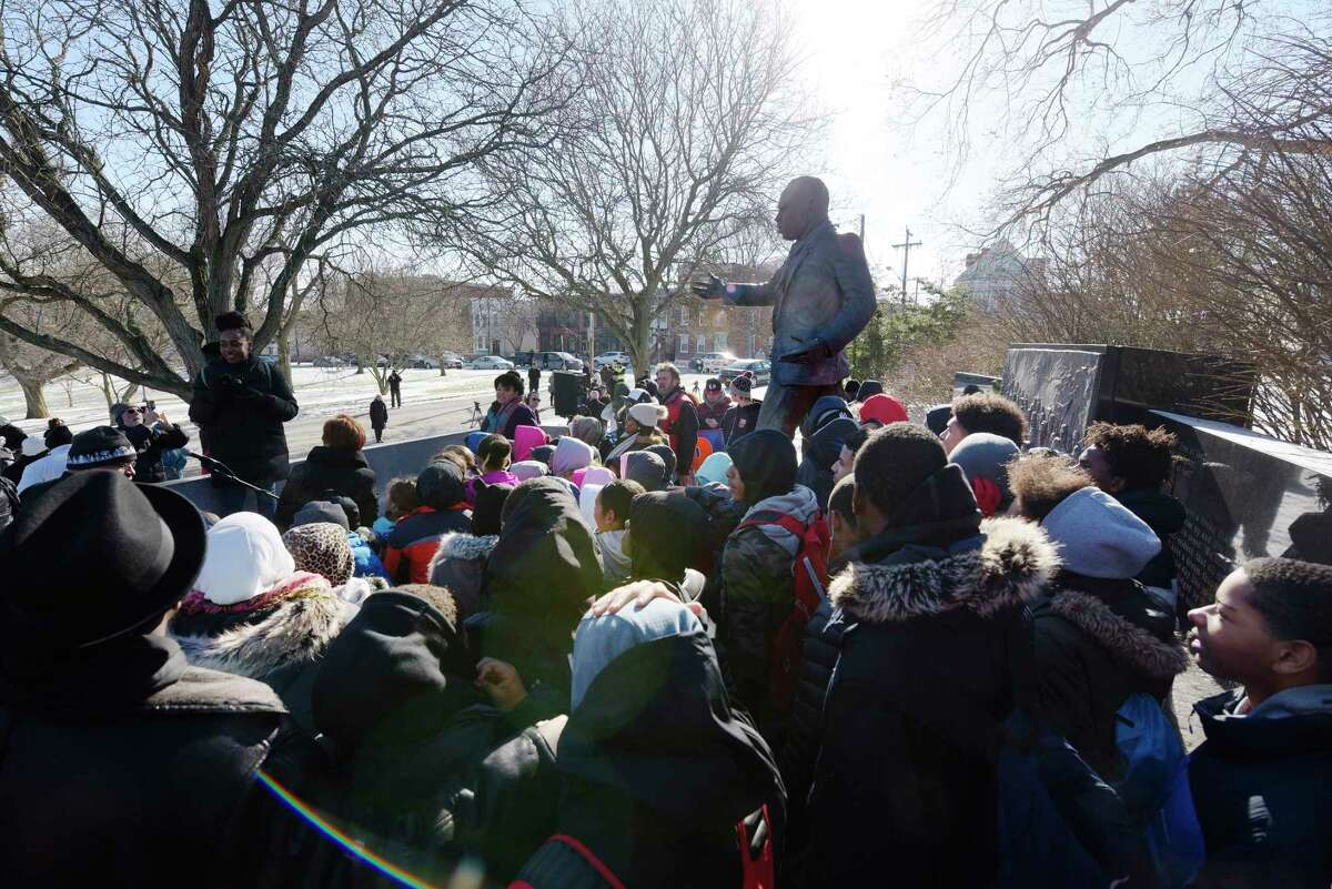 Children with 4th Family, Inc. organization gather at the Dr. Martin Luther King, Jr. Memorial in Lincoln Park following the New York State Dr. Martin Luther King, Jr. Memorial Observance Program on Monday, Jan. 15, 2018, in Albany, N.Y. (Paul Buckowski/Times Union)