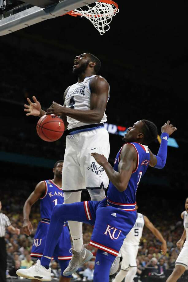 Villanova Wildcats' Collin Gillespie (2) dunks over Kansas Jayhawks' Lagerald Vick (2) during the first half of the National Semi-Final of the NCAA Final Four at the Alamodome.  Ed Ornelas/Express-News Photo: Ed Ornelas / Ed Ornelas/Express-News