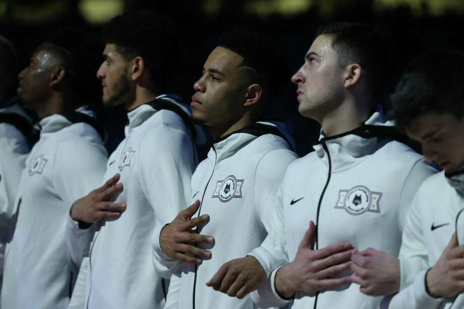 The University of Michigan men's basketball team stands during the National Anthem Saturday prior to the start of the  National Semi-Final of the NCAA Final Four agains Loyola Chicago at the Alamodome.  Jerry Lara/Express-News Photo: Jerry Lara / Jerry Lara/Express-News