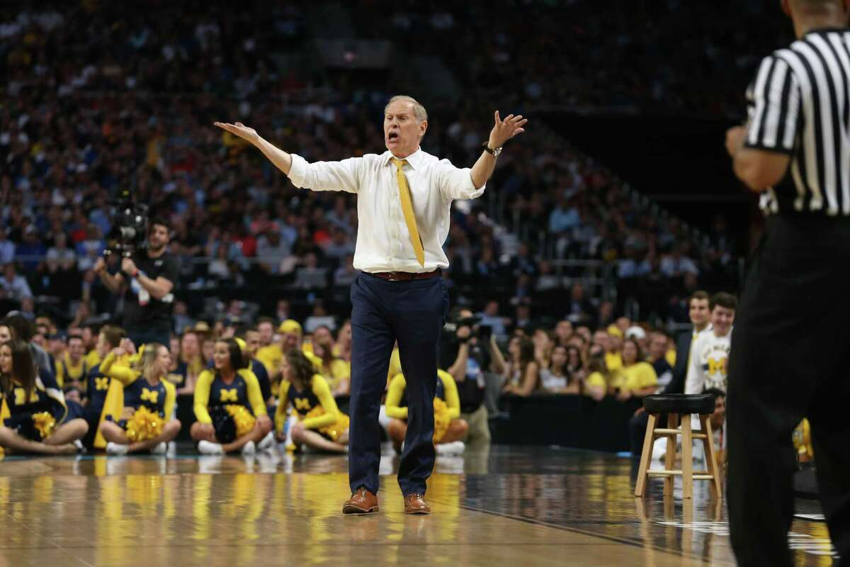 With a lead in the game over Loyola Chicago, Michigan Wolverines head coach John Beilein shouts instructions to his team in the closing minutes of of the National Semi-Final of the NCAA Final Four at the Alamodome. Jerry Lara/Express-News