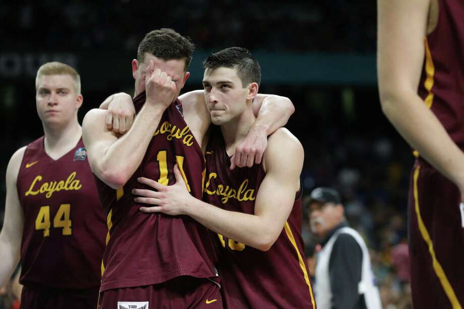 Loyola Chicago Ramblers' Ben Richardson (14), center, and Loyola Chicago Ramblers' Clayton Custer (13) walk off the court together after loosing to the Michigan Wolverines 69 to 57 in the National Semi-Final of the NCAA Final Four at the Alamodome on Saturday.  Tom Reel/Express-News Photo: Tom Reel / Tom Reel/Express-News