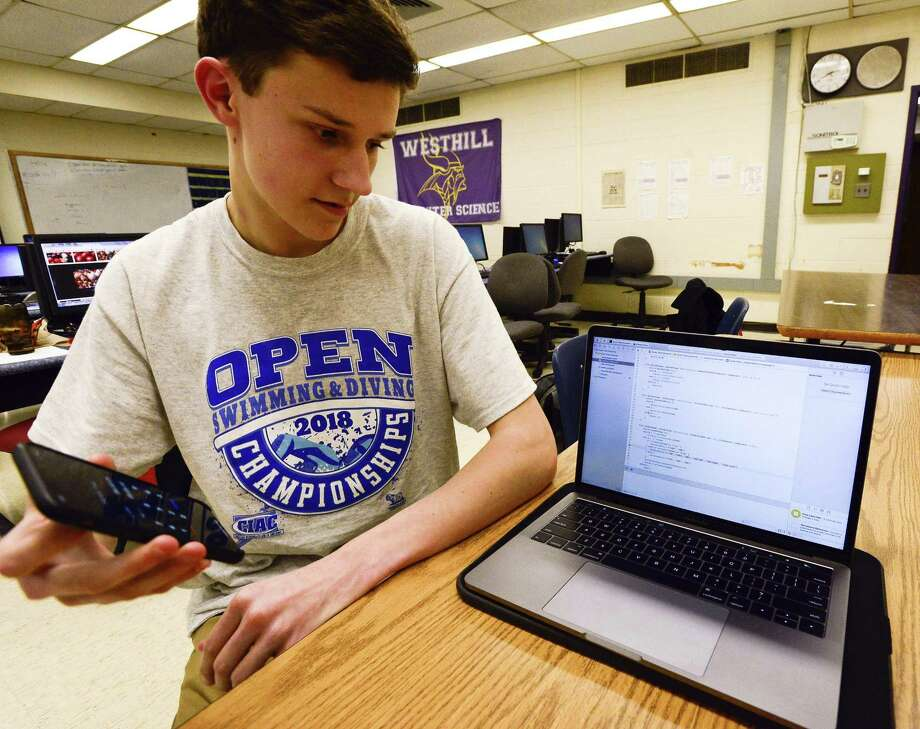 Kevin Zyskowski, a junior at Westhill High School is photographed at the school in Stamford, Conn. on Wednesday, March 28, 2018. Zyskowski, who's been swimming competitively since the age of 5, has developed an app to convert his swim times from pool yards to pool meters. The app is called Azure Time Converter and recently became available on the Apple app store last week. Photo: Matthew Brown / Hearst Connecticut Media / Stamford Advocate