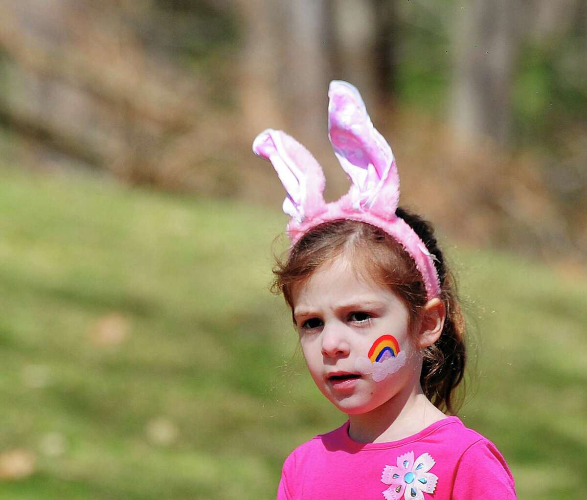 """Harper Hamm, 5, of New York City, wore bunny ears to the annual Easter Egg Hunt at the St. Francis Episcopal Church in Stamford, Conn., Saturday morning, March 31, 2018. Church parishioner Tyler Stevens who was one of the organizers of the event and who wore easter bunny ears to """"get in the spirit of the event,"""" also said that thousnads of eggs with treats were placed around the church for the many kids particiapting. Stevens also said """"We started the egg hunt a little early this year. The kids were doing face painting but were getting ansty for the egg hunt."""" St. Francis Episcopal Church Rev. Mark Lingle said about the annual event, the 10th the church has held, """"Just fantastic. Lots of young kids. It was great, from the arts & crafts and especially the egg hunt. Fantastic."""""""