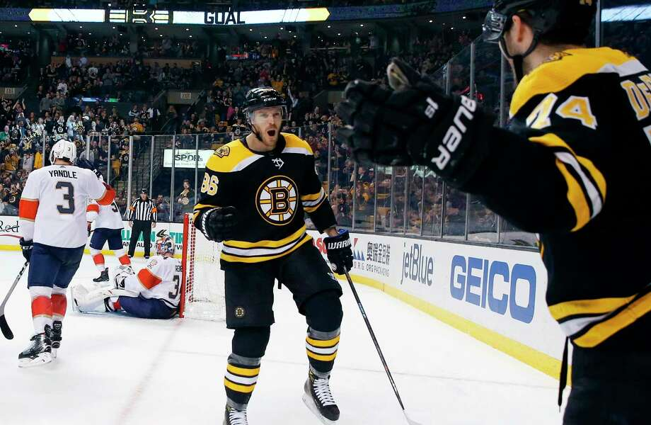 Boston Bruins' Jake DeBrusk (74) celebrates his goal with Kevan Miller (86) during the second period of an NHL hockey game against the Florida Panthers in Boston, Saturday, March 31, 2018. (AP Photo/Michael Dwyer) Photo: Michael Dwyer / AP2018
