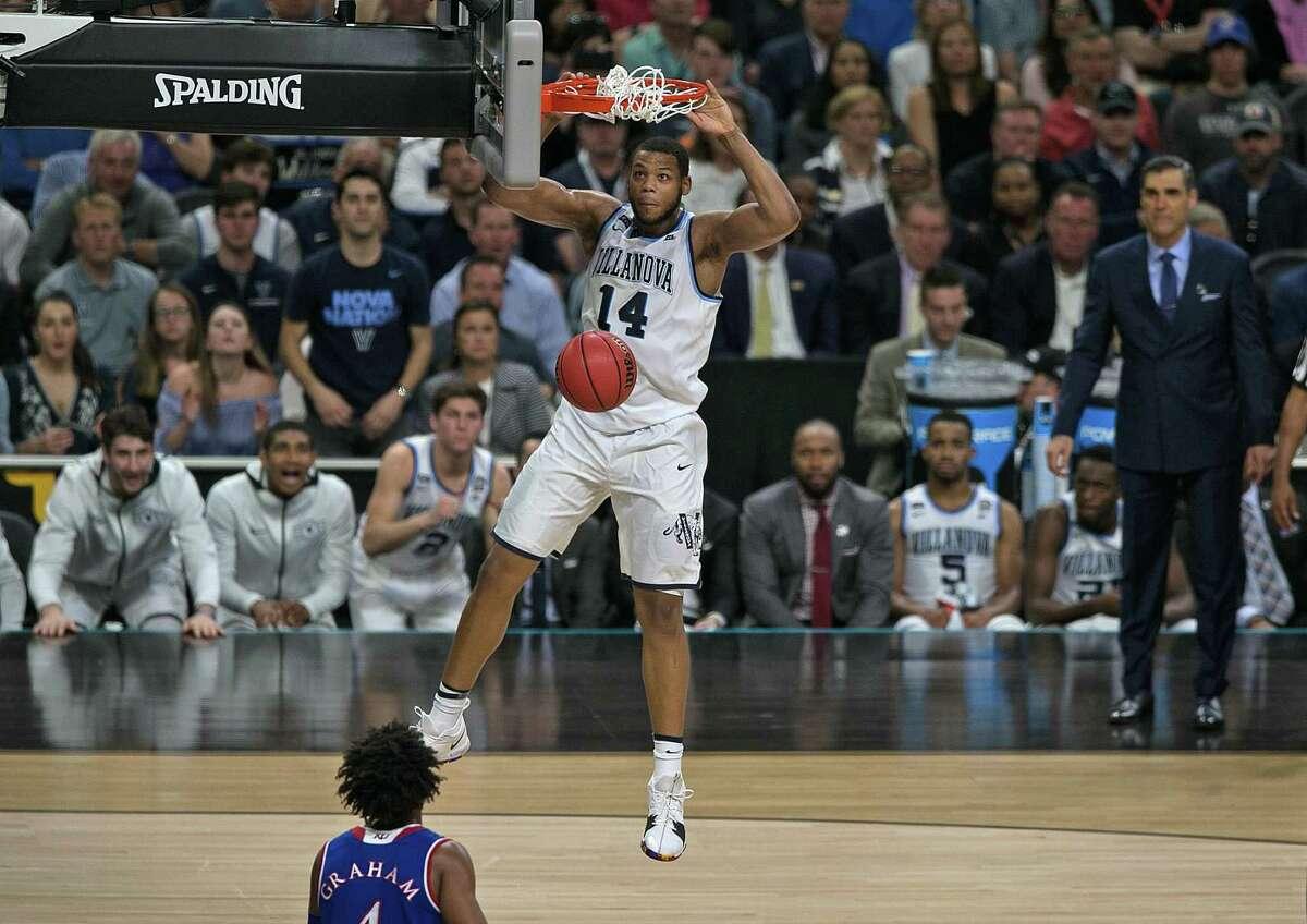 Villanova Wildcats' Omari Spellman (14) dunks late in second half. Villanova v Kansas in NCAA final Four semifinals on Saturday, March 31 ,2018 at the Alamodome