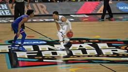 Villanova Wildcats' Jalen Brunson (1) prepares to drive on Kansas Jayhawks' Devonte' Graham (4). Villanova v Kansas in NCAA final Four semifinals on Saturday, March 31 ,2018 at the Alamodome