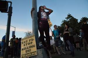 Cousin of Stephon Clark, Desoree Demard speaks to motorists at Florin Road and 65th on March 31, 2018 in Sacramento, CA.