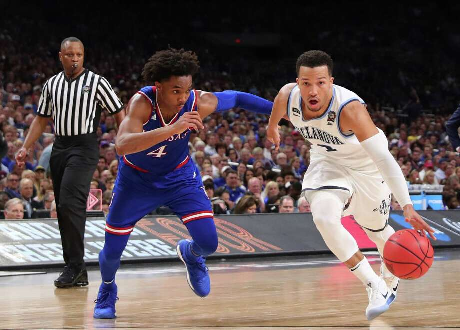 SAN ANTONIO, TX - MARCH 31:  Jalen Brunson #1 of the Villanova Wildcats is defended by Devonte' Graham #4 of the Kansas Jayhawks in the second half during the 2018 NCAA Men's Final Four Semifinal at the Alamodome on March 31, 2018 in San Antonio, Texas.  (Photo by Tom Pennington/Getty Images) Photo: Tom Pennington / 2018 Getty Images