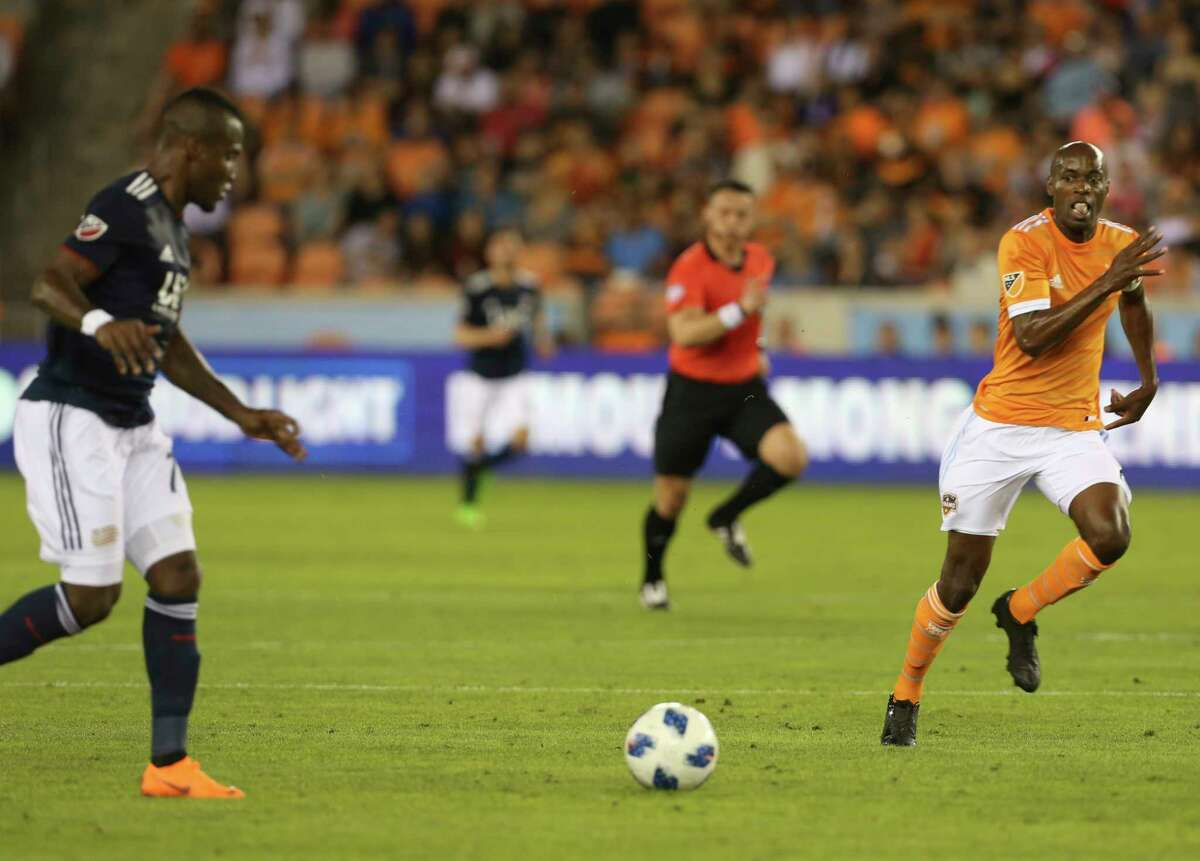 Houston Dynamo defender DaMarcus Beasley (7) tries to catch up New England Revolution forward Cristian Penilla (70) for the ball during the first half of the MLS game at BBVA Compass Stadium on Saturday, March 31, 2018, in Houston.