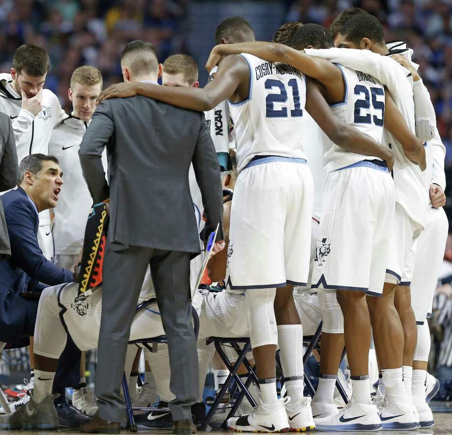 Villanova Wildcats head coach Jay Wright (left) huddles with the team during their 2018 NCAA Division I Men's Basketball Championship National Semifinal game against the Kansas Jayhawks held Saturday March 31, 2018 at the Alamodome. Photo: Edward A. Ornelas, Staff / San Antonio Express-News / © 2018 San Antonio Express-News