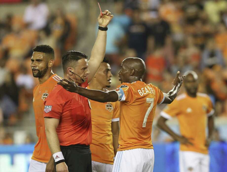 Houston Dynamo defender DaMarcus Beasley (7) receives a red card from Referee Sorin Stoica during the first half of the MLS game at BBVA Compass Stadium on Saturday, March 31, 2018, in Houston. ( Yi-Chin Lee / Houston Chronicle ) Photo: Yi-Chin Lee / Houston Chronicle / © 2018 Houston Chronicle