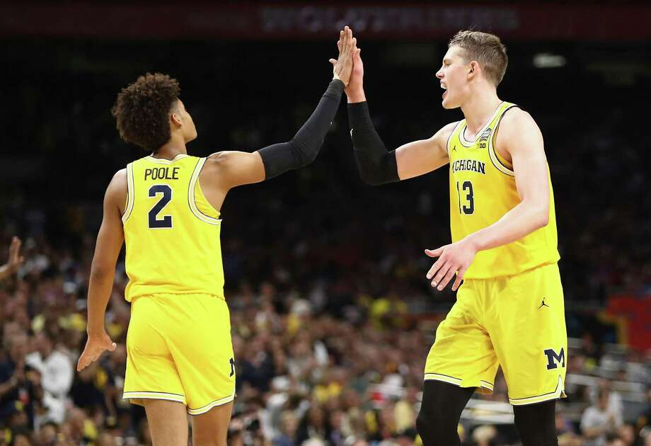 SAN ANTONIO, TX - MARCH 31:  Jordan Poole #2 and Moritz Wagner #13 of the Michigan Wolverines celebrate in the second half against the Loyola Ramblers during the 2018 NCAA Men's Final Four Semifinal at the Alamodome on March 31, 2018 in San Antonio, Texas.  (Photo by Ronald Martinez/Getty Images) Photo: Ronald Martinez / Getty Images / 2018 Getty Images