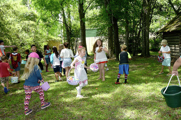 Children burst onto the grounds, quickly filling their baskets with eggs, during the annual Easter egg hunt at the John Jay French House Museum Saturday. In addition to the egg hunt, families enjoyed a tour of the historic home, crafts and photos with the Easter Bunny. Photo taken Saturday, March 31, 2018 Kim Brent/The Enterprise
