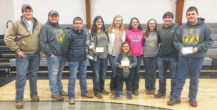 Jacksonville High School FFA's poultry tream recently placed first in varsity competition. Team members and their individual honors include Austin Dufelmeier (from left); Mike VanGiesen, fifth place; Dalton Bartz, third place; Chasey Tabit, second place; Katie White; Hanah Pullon; Savannah Jibben; Kassidy Upchurch, seventh place; Blake Hadden, sixth place; and Garrett Bruns, first place. Photo: Photo Provided