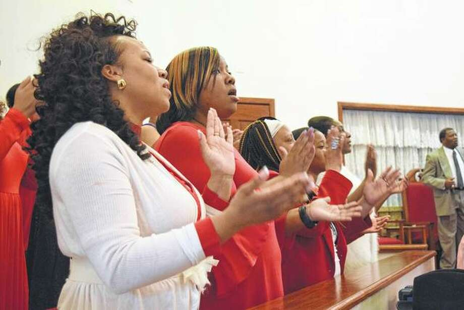 A combined church choir sings Saturday at the Pre-Resurrection High Praise Deliverance Service at Community Temple Church of God in Christ at 710 N. Clay Ave. Photo: Greg Olson | Journal-Courier